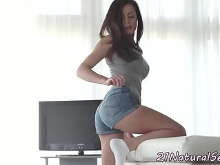 Alluring eurobeauty masturbating on couch